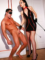 Sexy latex Domme uses sex slave