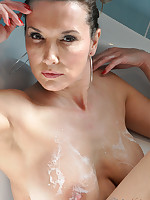 Jane gets her nylon stockings soaking wet as she takes a seductive bath