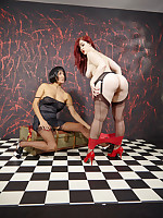 Two curvy girls slip into some sultry nylons and then have some strapon fun