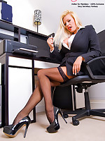 Pornstar Secretary Michelle Thorne Primes Her Pussy for Deep Play in Pinstripe and Stockings