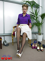 Naughty Pin-up Kelli Smith shows of her stockings with a sexy shoe shop strip