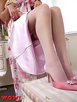 A sexy striptease by a cute blonde in a pretty summer dress, lingerie, stockings and suspenders.