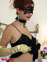 Gorgeous Pin-Up Elle Richie in sexy lingerie, stockings and masquerade mask