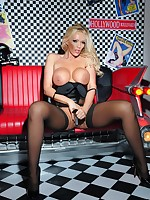 Glamour babe Lucy Zara is wearing her new black PVC corset and FF stockings