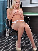 Stunning blonde Lucy Zara is dressed in a very sexy satin blouse with FF stockings and very tall high heels.