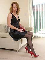 Alison is dressed to impress in her shiny black dress and red stilettos
