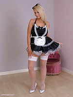 Sexy Maid Larissa in fishnet stockings and white stiletto shoes