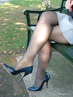Dark blue stilettos go well with this babes blue dress and dark stockings.