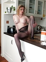 Holly is cooking up a tasty recipe in the kitchen in just a pair of pantyhose and heels!