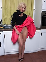 Anna getting excited on the kitchen counter in her glossy pantyhose!